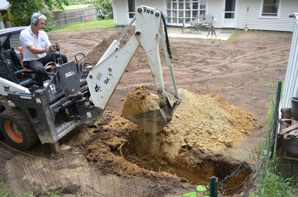 french-drain-dig-trench-backhoe